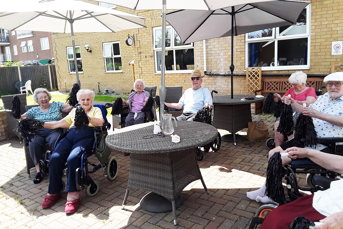 Sunflowers and gentle exercise in the garden at Silverpoint Court Residential Care Home