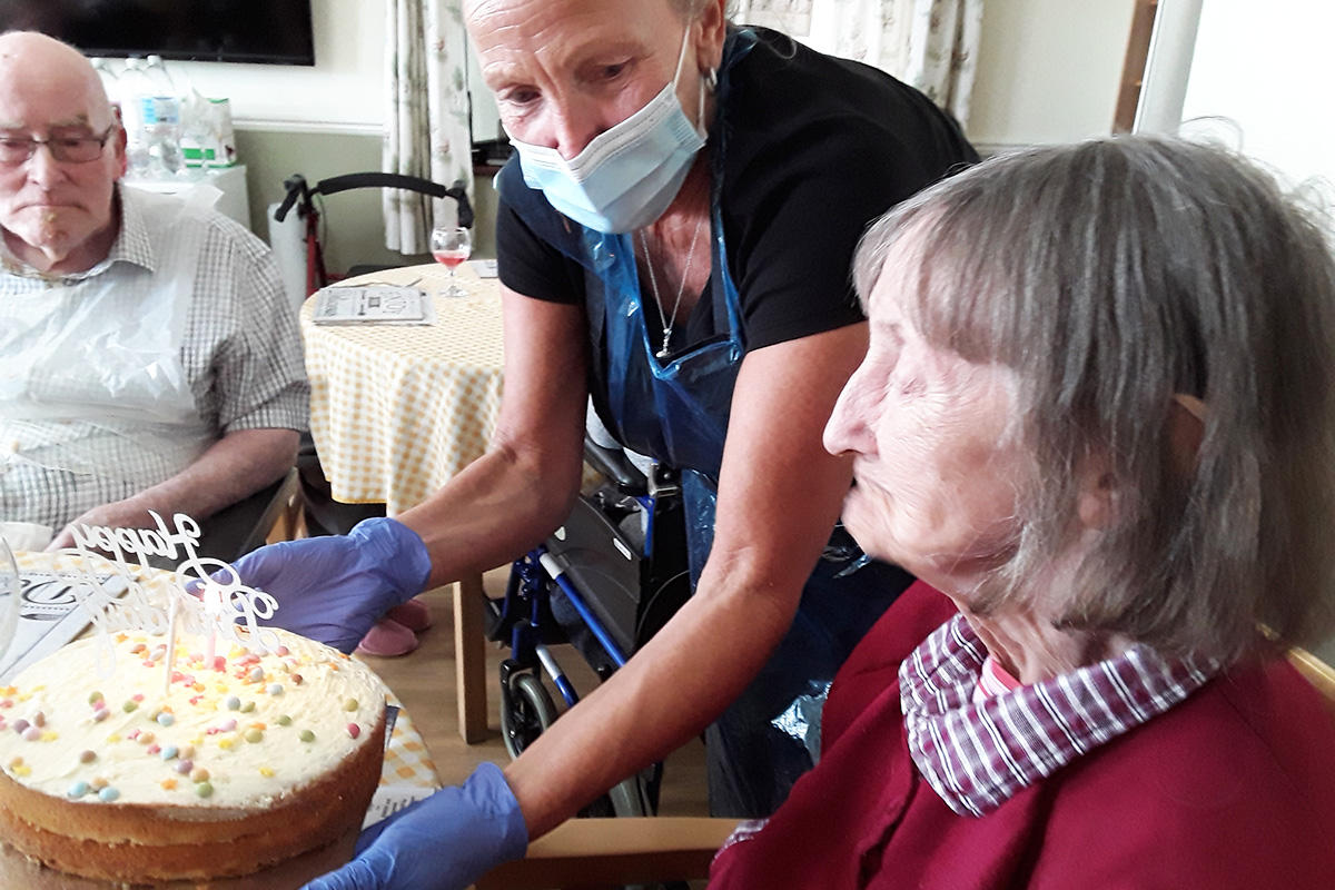 Silverpoint Court Residential Care Home receiving her decorated birthday cake