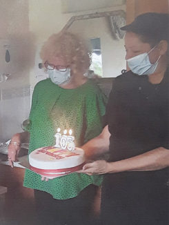 Family member with a birthday cake for her mother at Silverpoint Court Residential Care Home